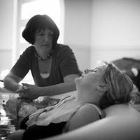 Jane palmer midwife attending a homebirth