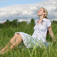 Pregnant woman in a meadow